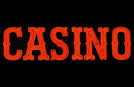 Red casino neon sign isolated on black 写真素材