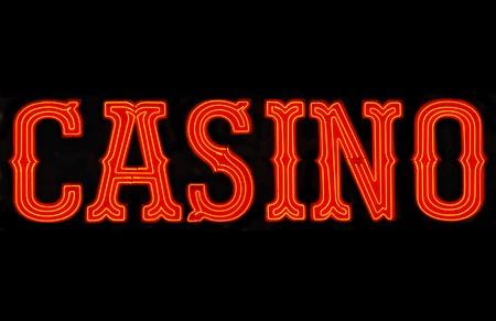 Red casino neon sign isolated on black Standard-Bild