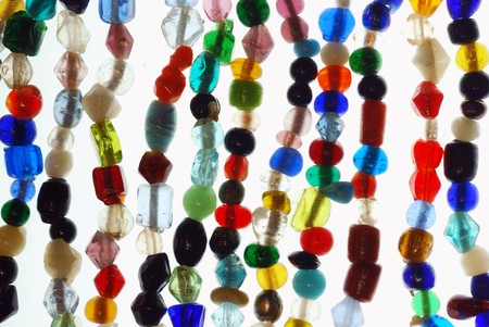 many colored: Strings of seed beads on a white background Stock Photo