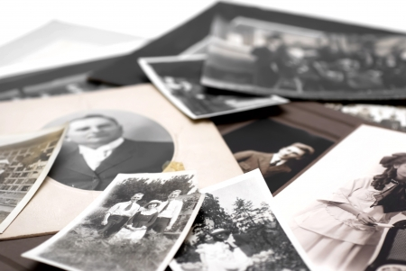 Closeup of a pile of vintage family photos Stock Photo