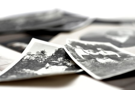 Closeup of a pile of vintage family photos Banco de Imagens