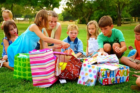 birthday party kids: Girl picks out a present at her birthday party