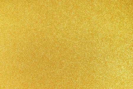Background filled with shiny gold glitter Standard-Bild