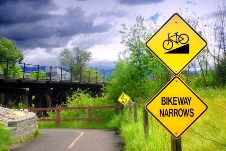 narrows: Bikeway narrows sign on bike path in Kalispell, Montana