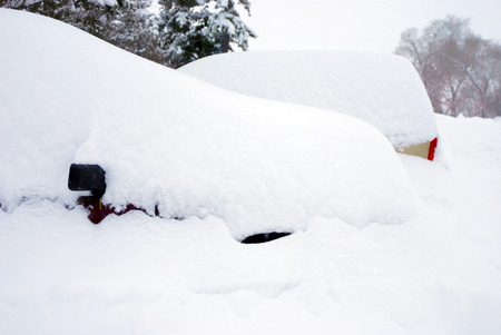 heap of snow: Two cars buried in two feet of snow Stock Photo