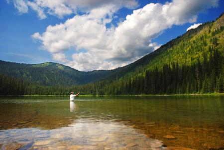 whitefish: Man fishing at Moose Lake near Kalispell and Whitefish, Montana Stock Photo