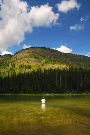 whitefish: Man fishing at Moose Lake in Whitefish Range near Kalispell, Montana