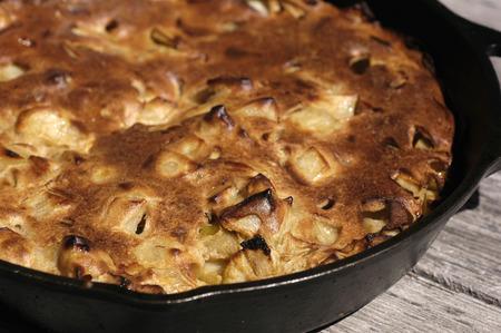 Apple pancake in a cast iron skillet Фото со стока
