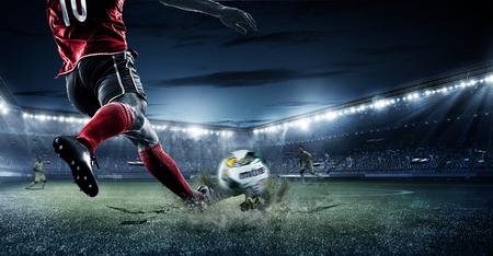 Player Shooting Ball football soccer stadium Stock Photo