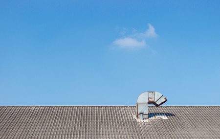 chimney on roof in blue sky photo