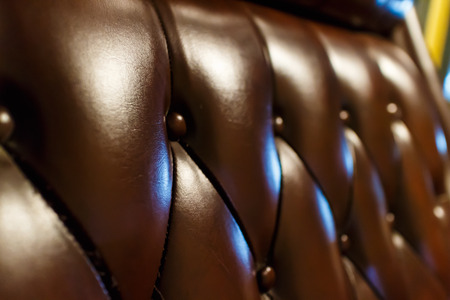 chambered: luxury leather sofa texture brown tone soft focus
