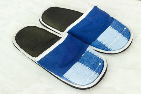 foot gear: A pair of blue slippers on a ground