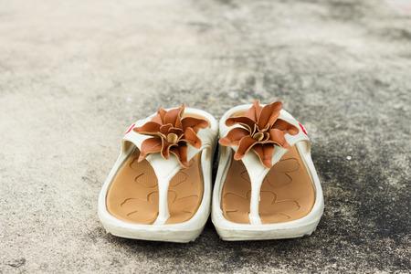 semen: brown flower on shoes on floor soft focus