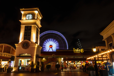 riverfront: BANGKOK, THAILAND - MAY 19: Clock tower and ferris wheel at Asiatique The Riverfront  on May 19,2015 in Bangkok, Thailand. Asiatique The Riverfront is a large open-air market Editorial
