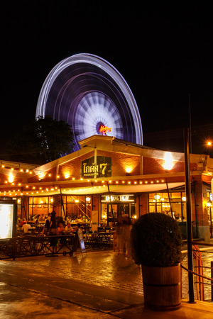 riverfront: BANGKOK, THAILAND - MAY 19: restaurant and  ferris wheel at Asiatique The Riverfront  on May 19,2015 in Bangkok, Thailand. Asiatique The Riverfront is a large open-air market