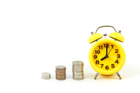 concept yellow alarm clock and thai baht coin isolation on white background