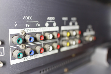 scart: close up back of TV video audio input with sign, selective focus