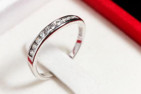 fiancee: close up silver diamond ring in red ring box