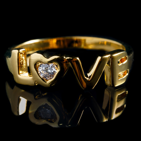fiancee: close up gold diamond ring with reflection