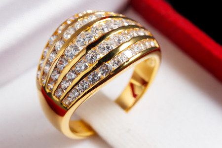 fiancee: close up gold diamond ring in red ring box