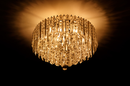 close up chandeliers hanging with black background