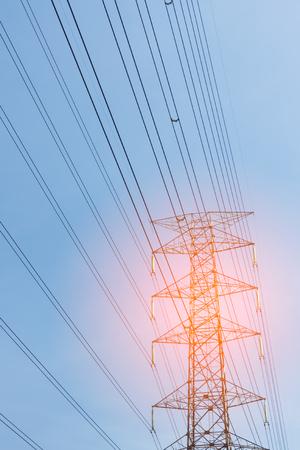 high voltage pole on blue sky background