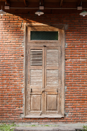 old vintage texture of brickwall and wooden door for background photo Stock fotó