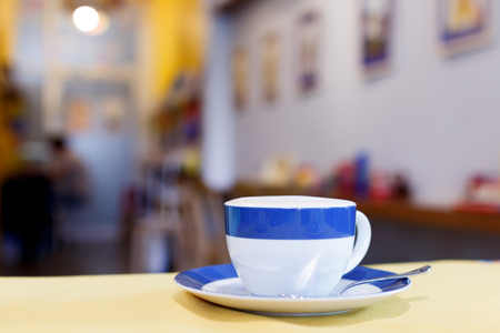 close up blue and white a cup of coffee on table