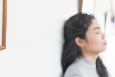blur woman lean on wall for background