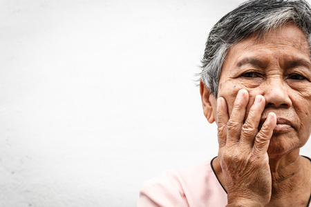 close up asian old woman hiding face with her hands Stock Photo