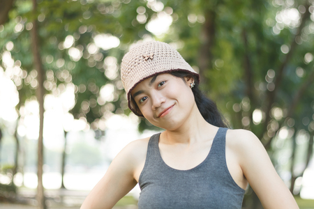beauty asian woman in sportswear running in park, healthy lifestyle, on blur natural background