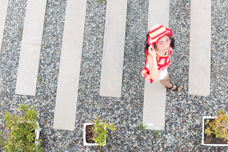 woman in colorful knitwear is walking take from top view