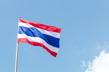 Thailand flag blowing with wind on blue sky background