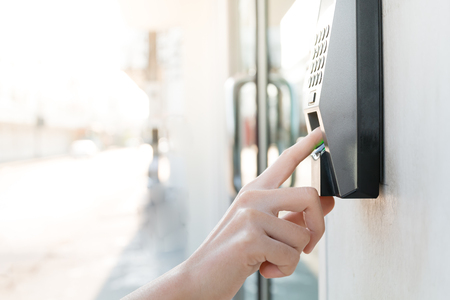 close up hand of asian woman scanning fingerprint
