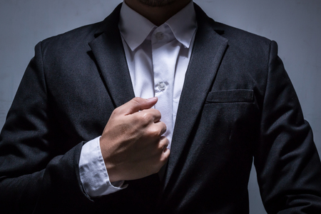 close up hand of smart businessman with black suit Stockfoto