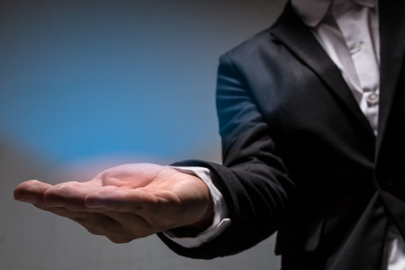 close up hand of businessmanwith black suit and light effect