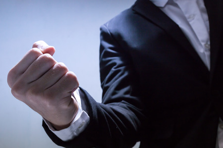 close up hand of businessman with black suit, fighting concept