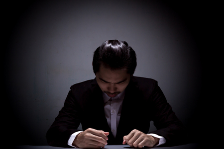 portrait of businessman with black suit, businessman being confusion