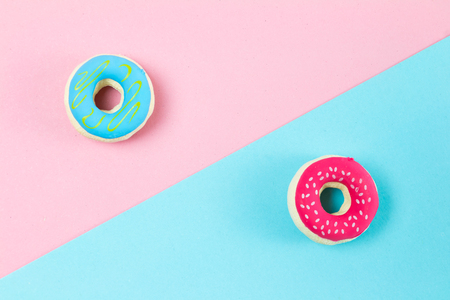 creative concept with donut and pastel color tone background