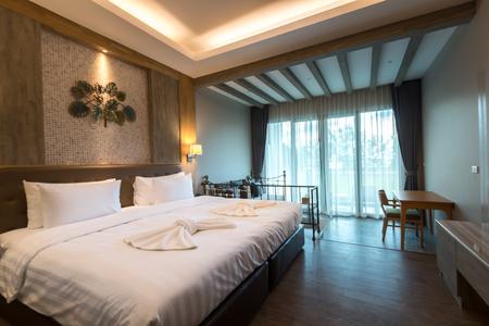 white bed in luxury bedroom of resort in Thailand