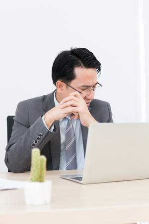 asian business man sitting in office and use laptop, stress concept Stock fotó