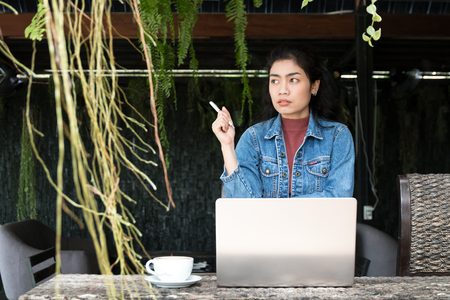 business asian woman with laptop and white cup of coffee on outdoor, relaxation concept