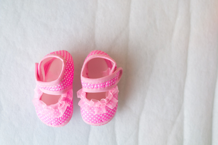 close up pink baby shoes on mattress, newborn concept Stock fotó
