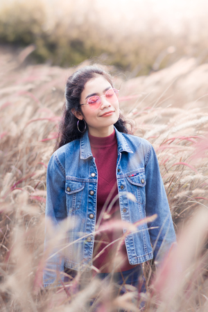beauty asian woman with red shirt and jean jacket in beautiful place Stock fotó
