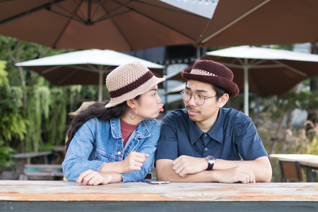 couple asian man and woman with woolhat happy and fun,tease and playing emotion concept