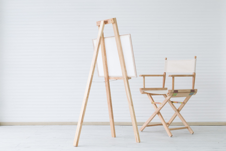 modern wooden chair and painting board  on clean room