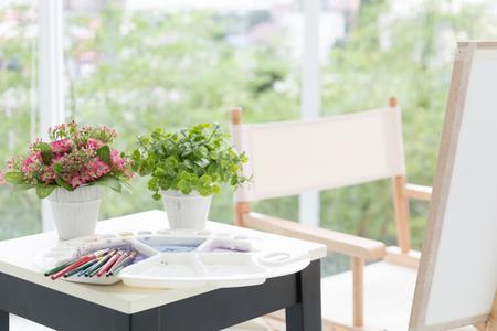 equipment art paiinting and flower on modern table Stock fotó
