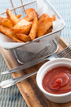 close up french fries and ketchup on wooden plate Stock fotó