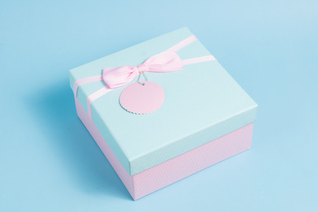 close up pink and blue gift box pastel color on blue blackground Stock fotó