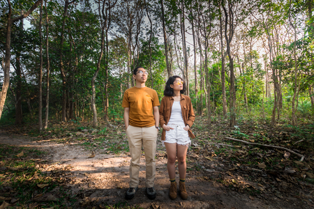 couple asian man and woman traveler at amazing forest Stock fotó